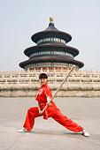 中国武术--一名女武术运动员在天坛祈年殿前练刀法