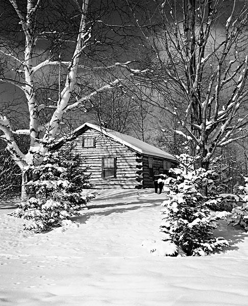覆盖着白雪的小木屋