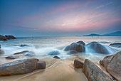海南礁石滩日落